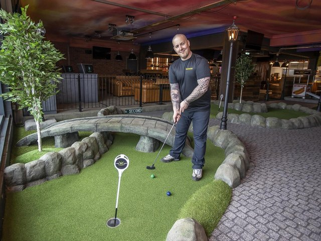 Caddy Shack general manager Peter Petter has a go at the mini-golf course