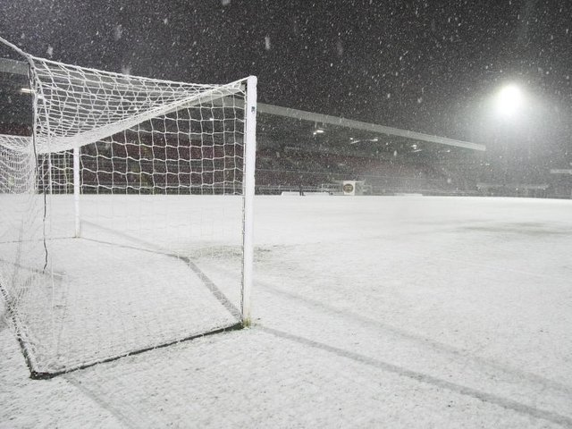 Snow covers the Sixfields pitch in October 2008. Photo: Getty Images