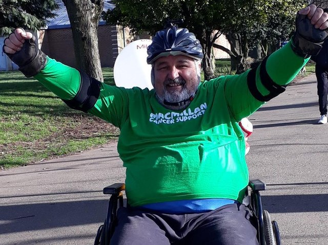 Alan Hackett clocked up 60 miles in his wheelchair over 26 days, finishing on his 60th birthday.