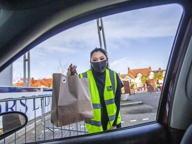 Food is delivered to customers' cars after orders are placed on an app. Photo: Kirsty Edmonds.