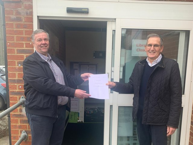Councillor Murray, chairman of the parish council (left) handing the lease over to Roger Wood, chair of Roade Junction Community Group (right).
