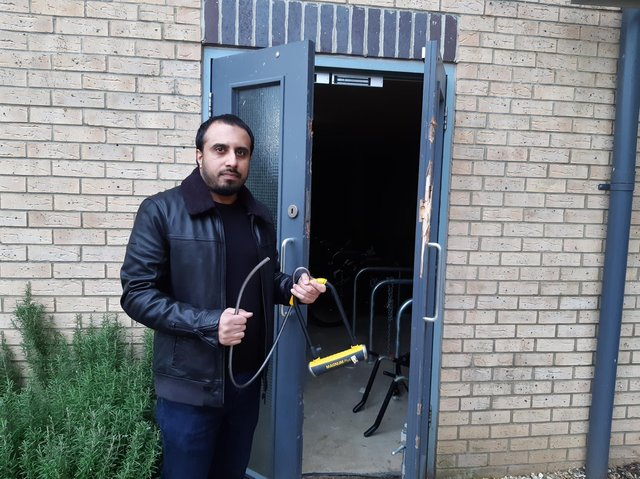 Tanvir outside the bike storage area with his snapped lock
