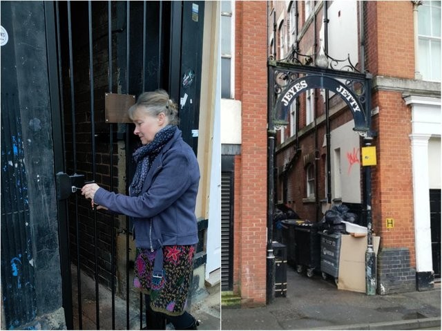 Sarah Matcham (left) - mother of Bradley Matcham who died after being punched in the alley - closing the newly installed gates.