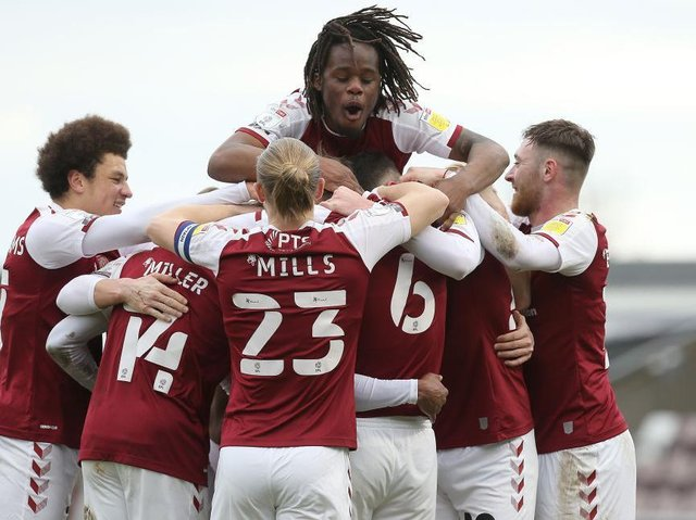 The Cobblers players celebrate after Sam Hoskins goal made it 4-0 against Portsmouth (Pictures: Pete Norton)
