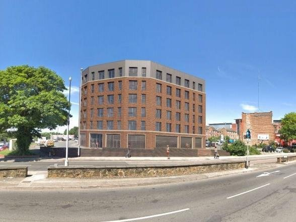 An artist's impression of what the block of flats would look like on the corner of St Peter's Way and Horsehoe Street.