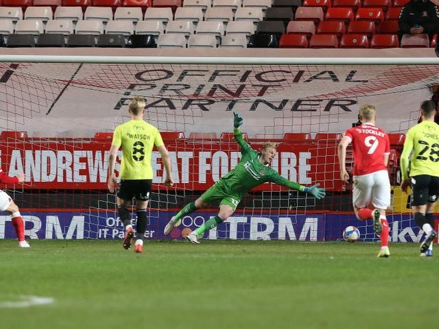 Conor Washington places his penalty out of the reach of Jonathan Mitchell. Pictures: Pete Norton.