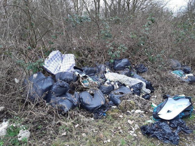 Around three tonnes of fly-tipping in fields by the A605 near Lilford were the first to be cleared as part of the Northamptonshire police, fire and crime commissioner's scheme