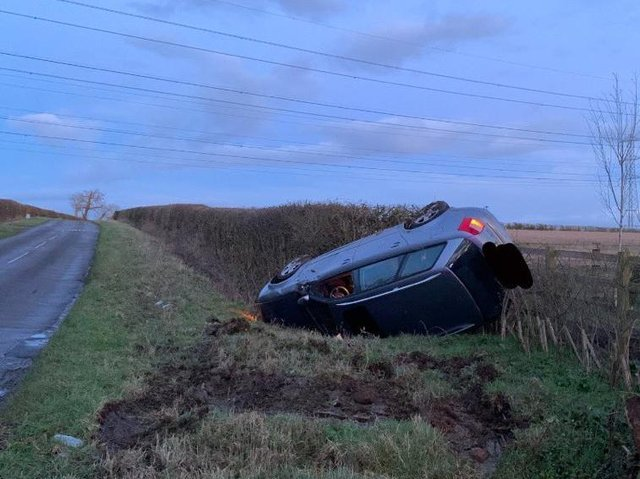 The driver walked away uninjured after his vehicle ended up upside down in a ditch. Photo: @WellingbSC