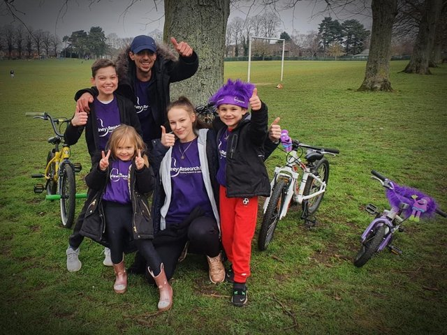 Logan (right) with his mum, dad, sister and cousin as they start to clock up the miles for the challenge.