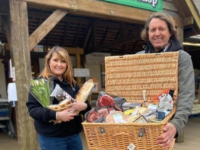 Emma from Sauls and Adrian from Smiths Farm Shop with the winning hamper.