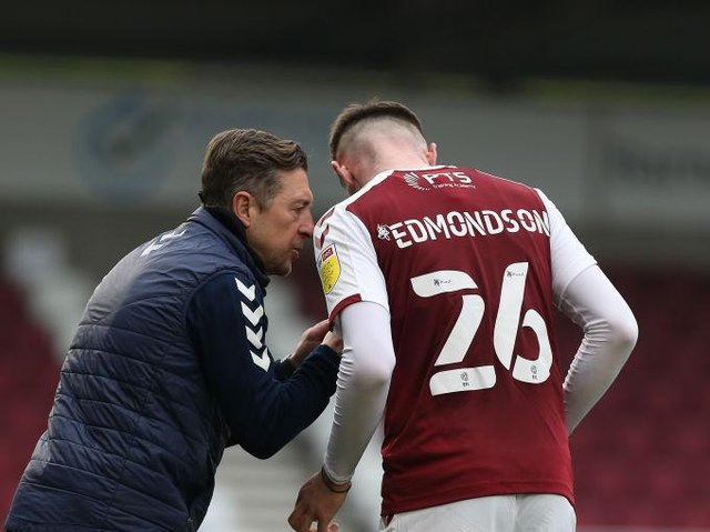 Jon Brady gives some instructions to Ryan Edmondson during Saturday's game against Crewe.