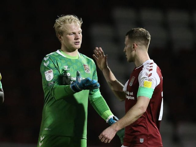 BIG WIN: Bryn Morris and Jonathan Mitchell salute a job well done by the Cobblers on Tuesday. Pictures: Pete Norton.