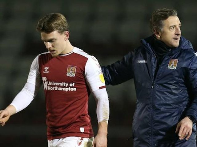 Jon Brady had a chat with Sam Hoskins on the pitch following Tuesday's win. Pictures: Pete Norton.
