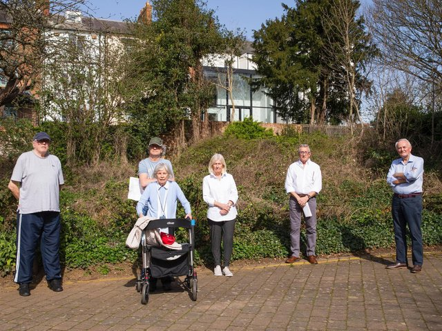 David (far right) and the Scholars Court residents standing behind the Mackintosh house