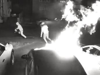 Two yobs are caught on camera torching three cars on a drive in Weedon in the early hours of Tuesday