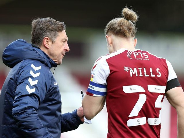 Jon Brady gets a message across to Joseph Mills during the Cobblers' Good Friday win over Shrewsbury Town (Picture: Pete Norton)