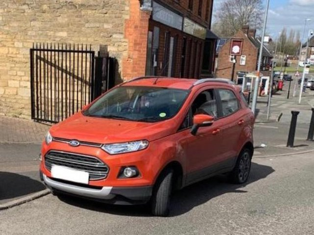 The stolen red Ford Ecosport Titanium Turbo recovered in Corby yesterday.