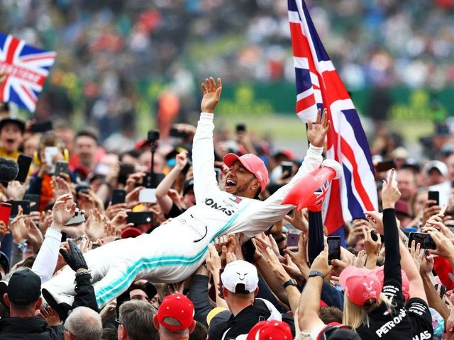 Lewis Hamilton celebrates with fans after winning the British Grand Prix at Silverstone in 2019. Photo: Getty Images