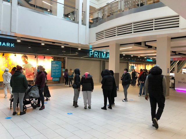 Shoppers queue outside Primark in Northampton Grosvenor Centre for 8am opening