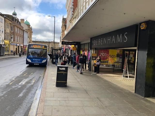 Shoppers queued outside Debenhams in the Drapery