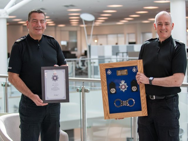 Chief Constable Nick Adderley bids a fond farewell to ACC James Andronov (right)