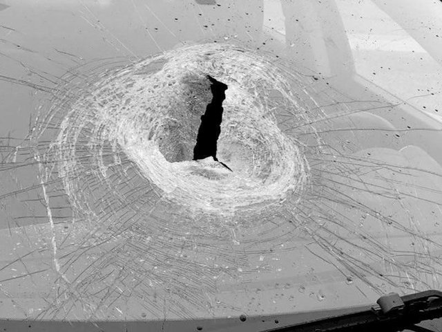 This photo shows the damage caused by a stone being dropped on to the windscreen of a car travelling at speed