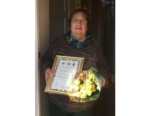 Jenni Liversidge, of Weedon Lois and West WI, with her Rose of Northamptonshire award