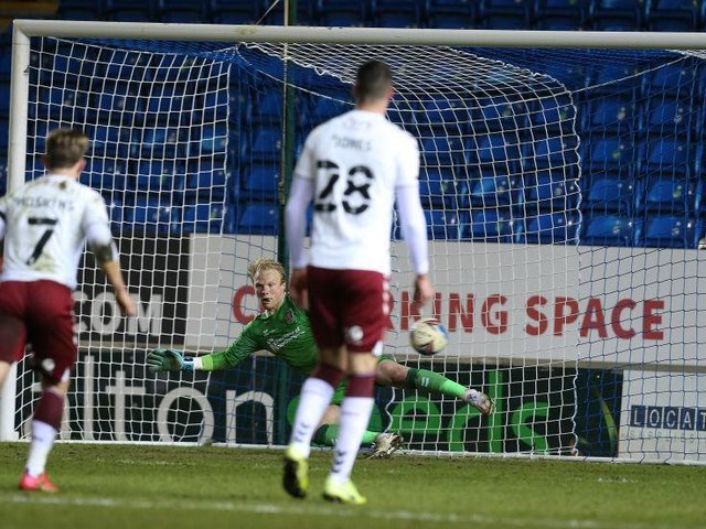 Jonathan Mitchell can only watch on as Jonson Clarke-Harris slots his penalty down the middle. Pictures: Pete Norton.