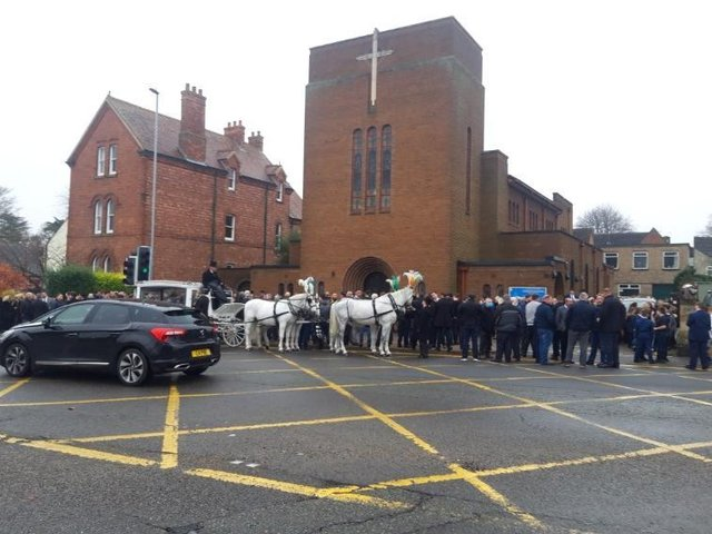 Mourners outside the church at the funeral.