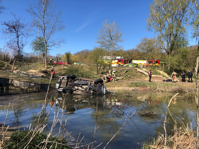 The car left the road and plunged down the embankment into Corby Boating Lake