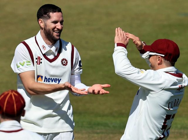 Wayne Parnell celebrates after claiming his first wicket for Northants, Glamorgan opener David Lloyd