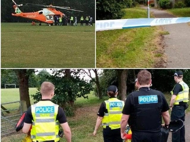 Police and the air ambulance at Ecton Brook Playing Fields after a man was shot and stabbed in July 2019
