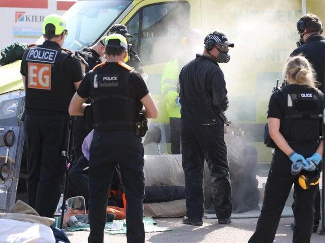 Police used cutting tools to free protesters outside the new Five Wells prison