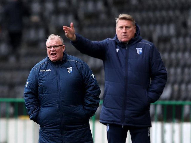 Steve Evans and his assistant Paul Raynor.