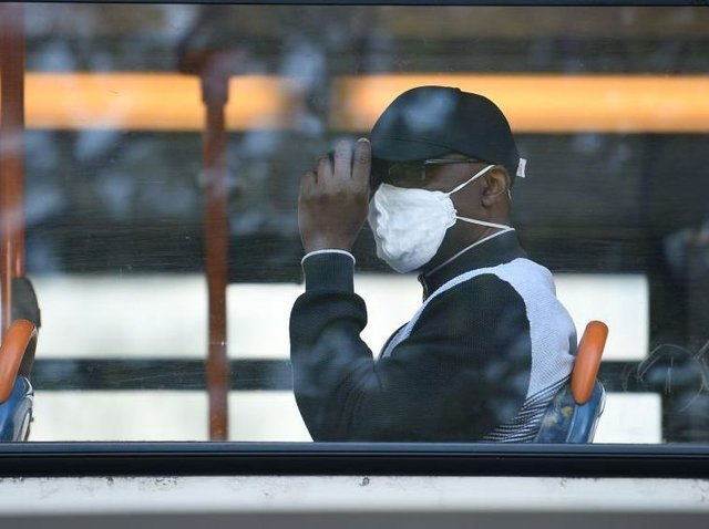 Face coverings have been mandatory in shops and on public transport since last year with £200 fines for those who flout the rules.