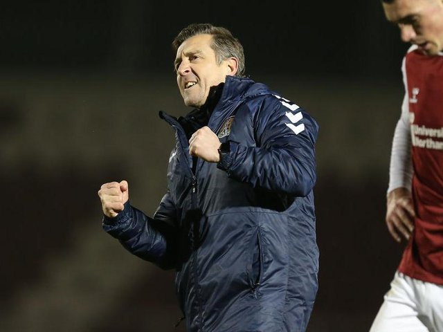 Jon Brady celebrates his first win as caretaker manager against Plymouth.
