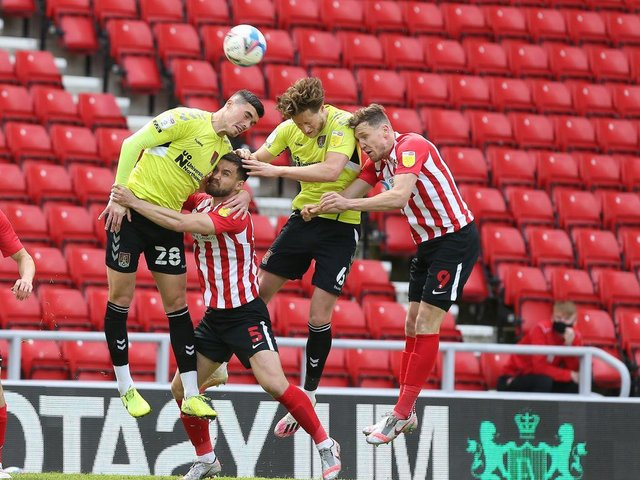 Fraser Horsfall and Lloyd Jones challenge for a header at the Stadium of Light. Pictures: Pete Norton.