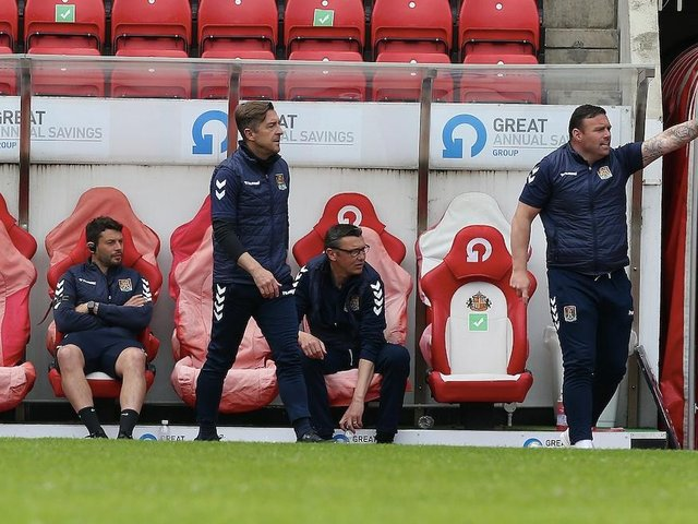 Jon Brady and his coaching staff during Sunday's game at Sunderland. Picture: Pete Norton.
