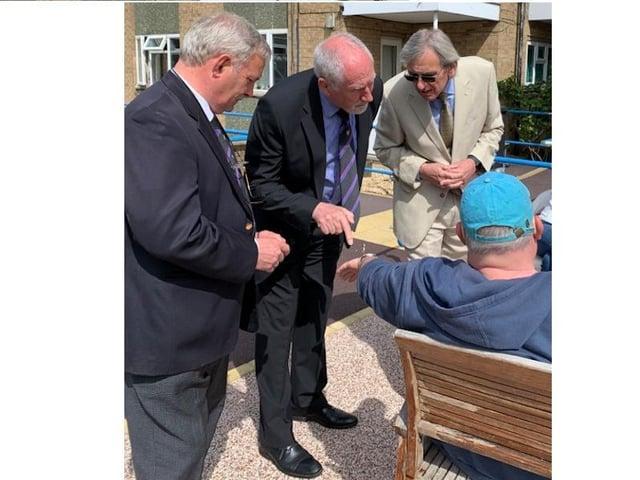 Freemasons Andrew Ward, David Burton and Gerry Crawford meeting Deafblind UK members