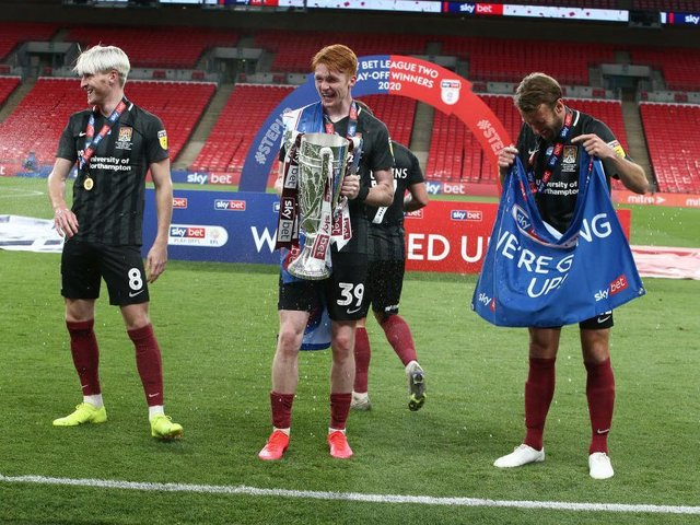 Callum Morton with the play-off trophy. Pictures: Pete Norton.
