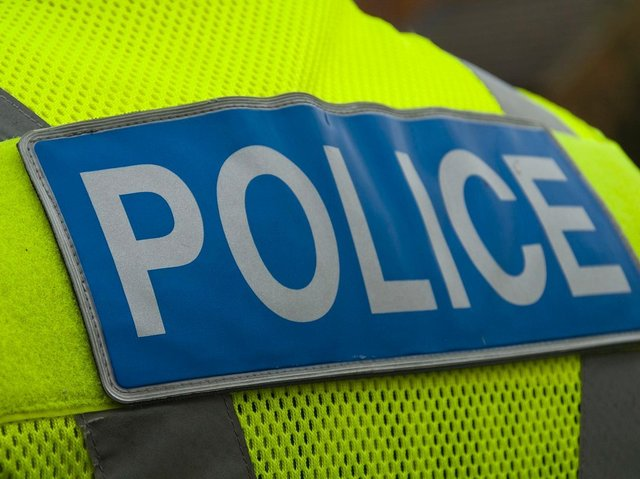 Two officers were assaulted while attempting to arrest a woman in St James on Saturday night