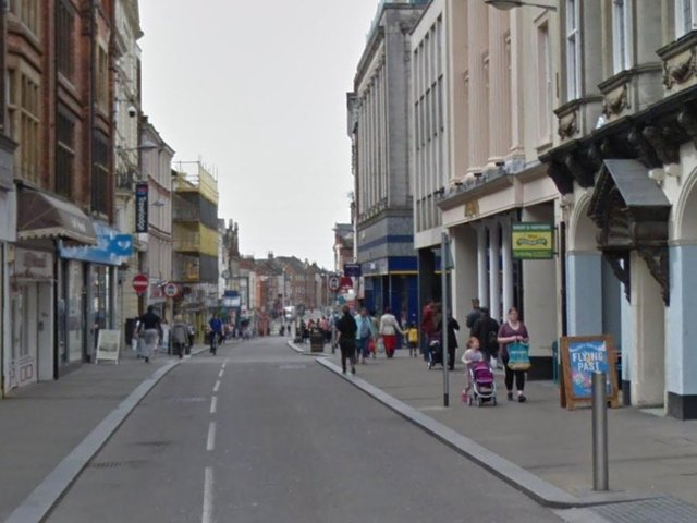 A dangerous driver mounted the kerb on Gold Street and drove at pedestrians to escape police.