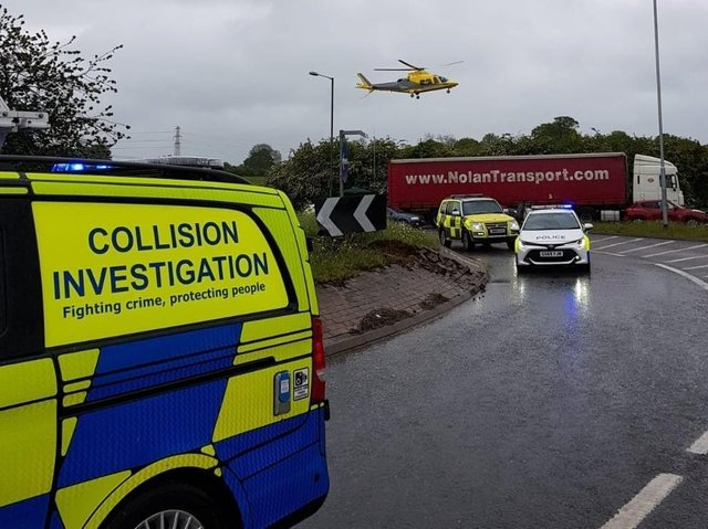 An Air Ambulance at the scene of this morning's crash but sadly a lorry driver later died.