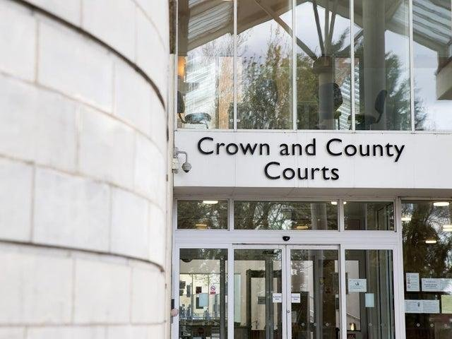 A trial has begun over the alleged rape of a woman in a Northampton bedsit.