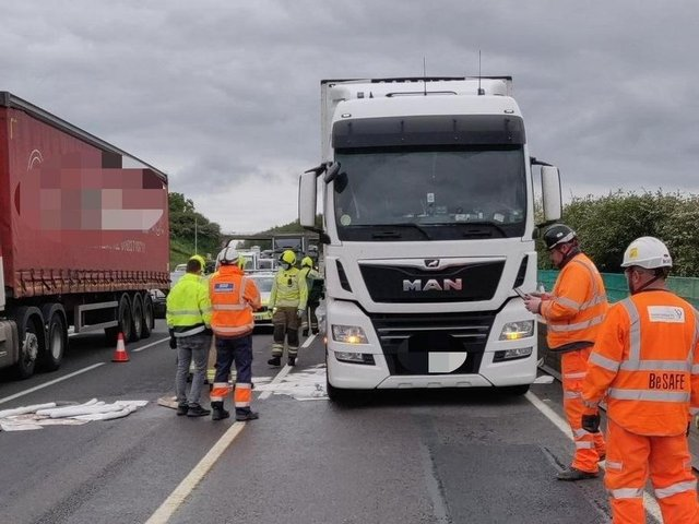 Crews work to mop up 400 litres of diesel from the M1 on Tuesday afternoon