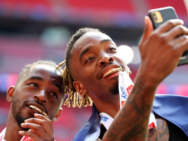 Ivan Toney savours Brentford's promotion to the Premier League with team-mate Tariqe Fosu at Wembley on Saturday
