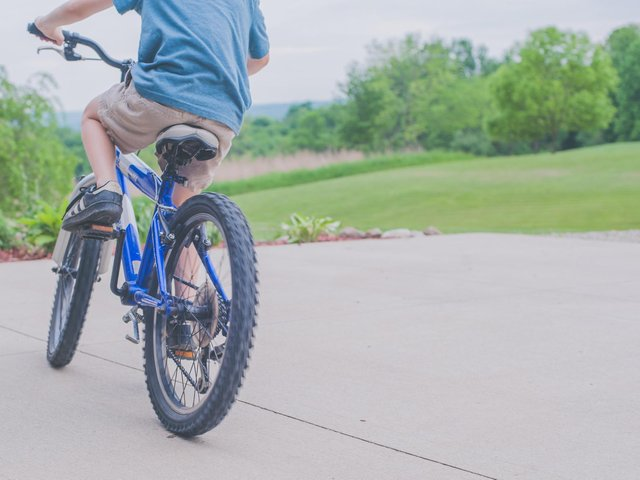 A teenage girl was pushed off her bike, causing her to break a finger.