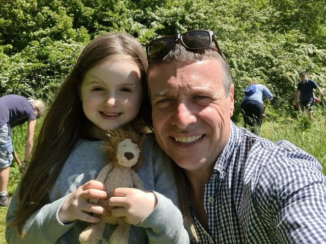 Iain Welters with his goddaughter Peggy.