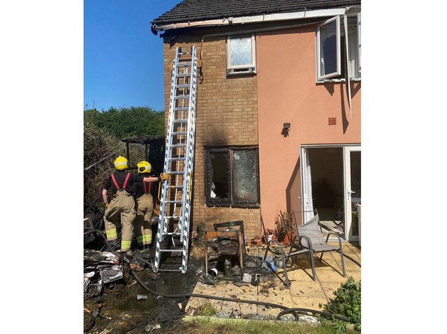 Firefighters at a house in Northampton damaged by a fire caused by burned waste that was not completely extinguished. Photo: Northamptonshire Fire and Rescue Service