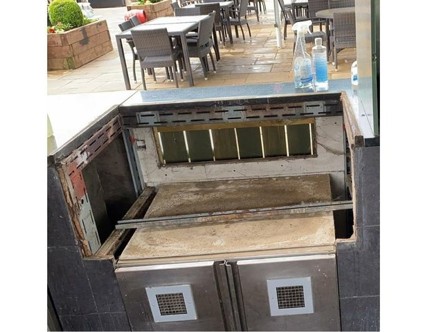 This is the empty space left at the Brampton Halt's outdoor kitchen after thieves stole the entire station overnight.